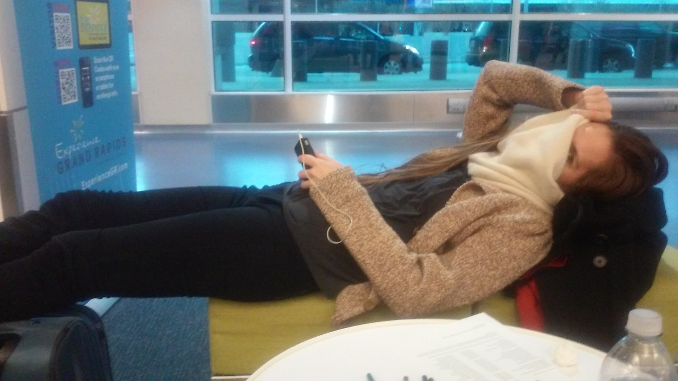 Laura is napping at the airport.
